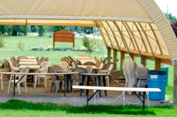 The Village Green offers a large tent for outdoor banquet and meal settings